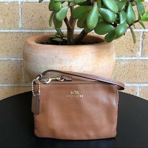 Coach New York brown leather corner zip wristlet